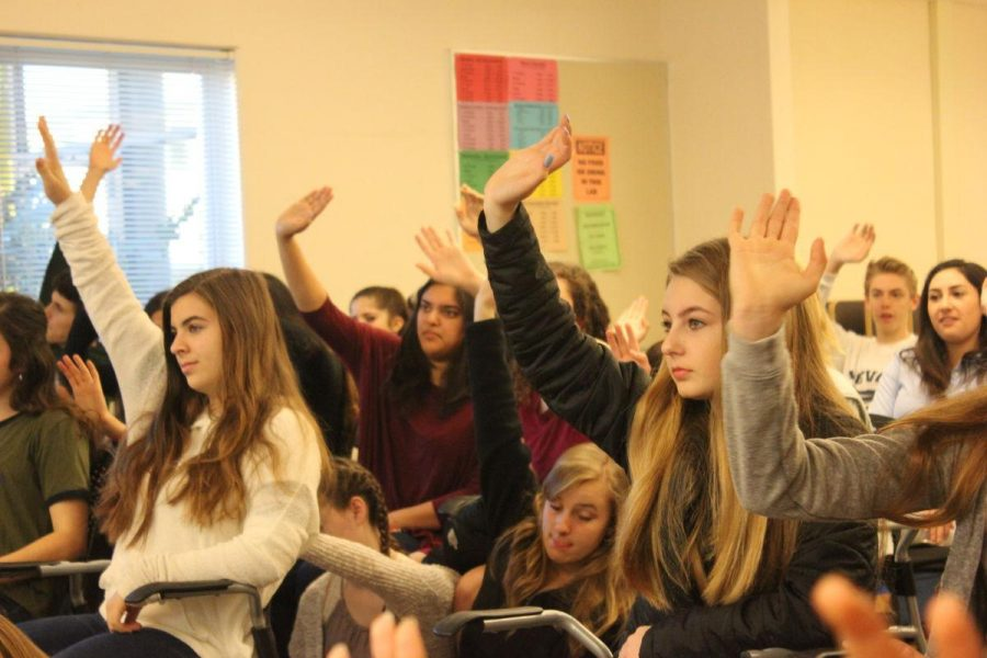 Students vote during an ASB meeting.
