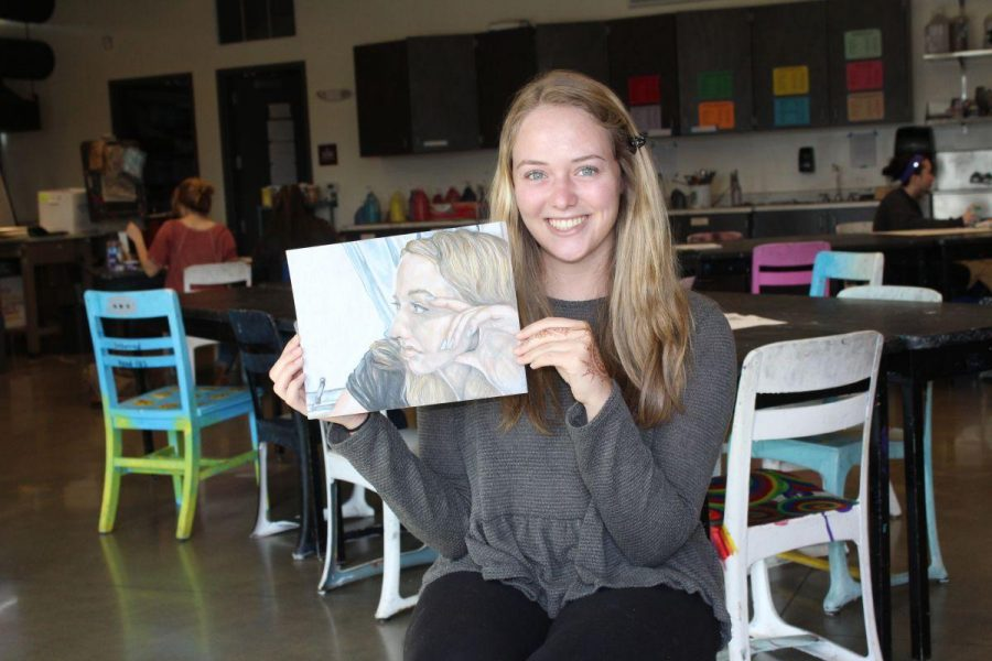 Bjursten poses with the drawing that won her the Silver Key Award.