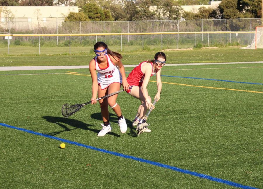 Sophomore Violet Loo chases the ball down the field.