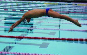 DIVING OFF the starting block, Kurakin competes for Redwood and North Bay Aquatics.