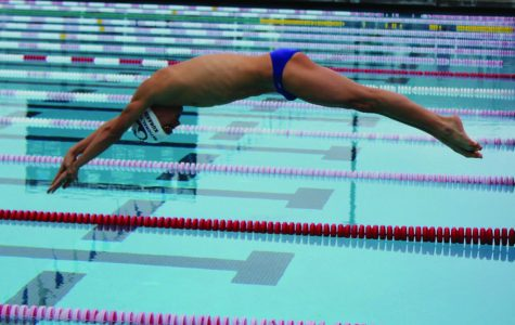 DIVING OFF the starting block, Kurakin competes in yet another swim meet.