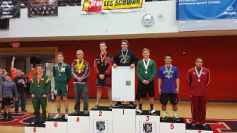 Standing atop the podium, senior Riley Dow takes in the moment after placing second in the NCS tournament. This win sent him to the CIF state tournament, where he was defeated by the fifth-ranked wrestler in California.
