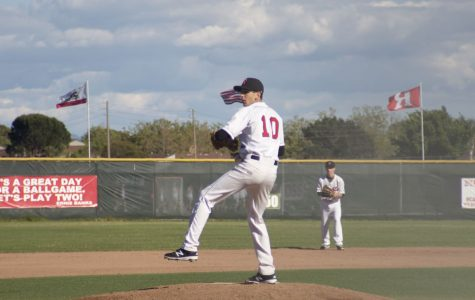 Sophomore Josh Cohen winds up to pitch.