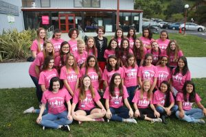 """POSING WITH THEIR keynote speaker, ambassadors from the Marin Teen Girl Conference prepare for a day of empowering other girls to """"be their own superhero."""""""
