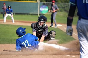 Trevor Foehr tags out Branson's Ethan Terrell in the bottom of the first.
