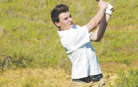 Following through, junior Grant Wyman watches his shot during a match