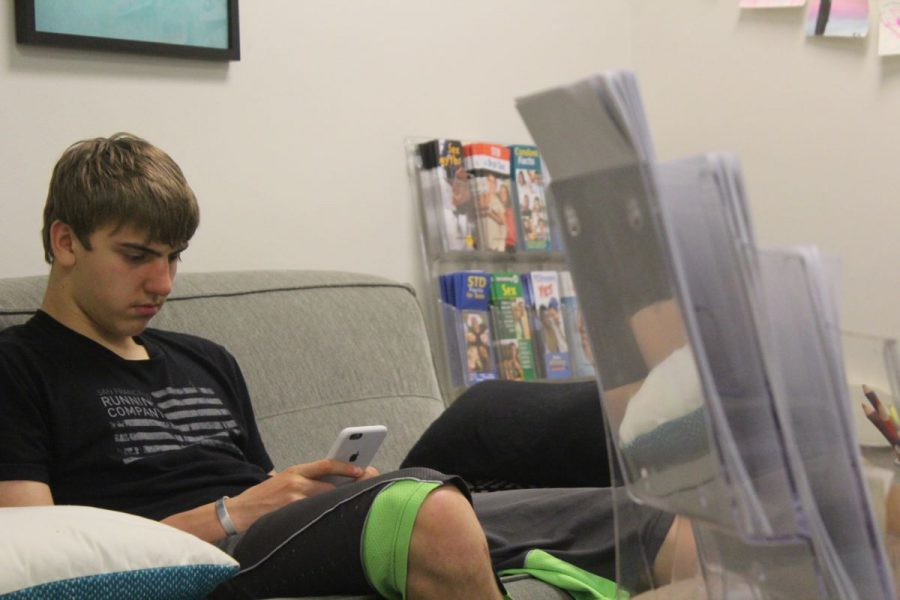 Sophomore Kent Harrison relaxes in Redwood's Wellness Center.