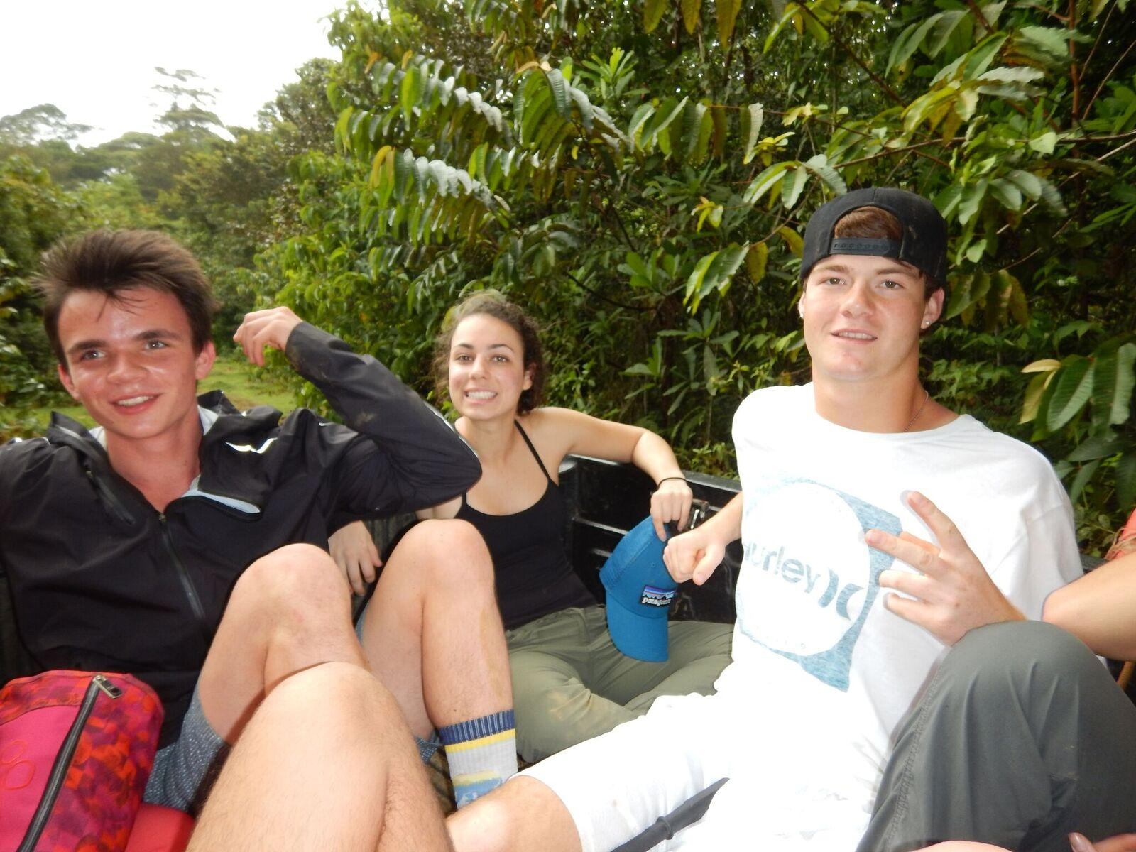 Zadoff (far left) and friends sit on the back of a truck after working in Panama