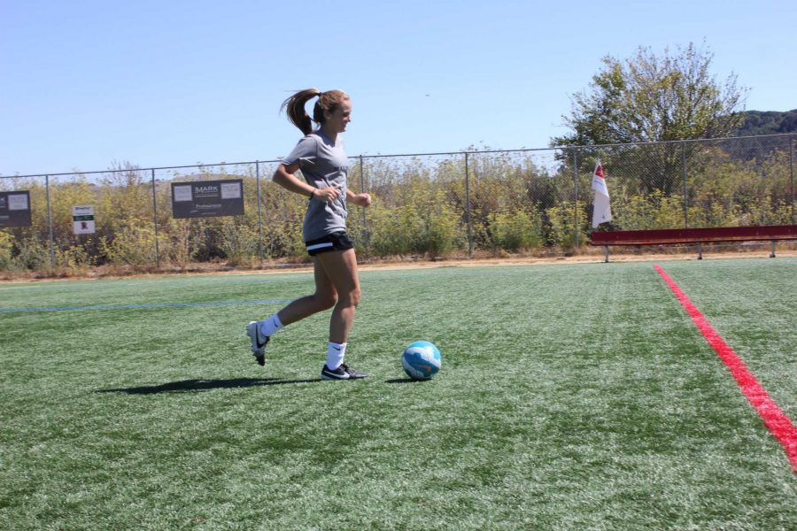 Practicing for the upcoming season, Lauren Foehr kicks the ball down the field.