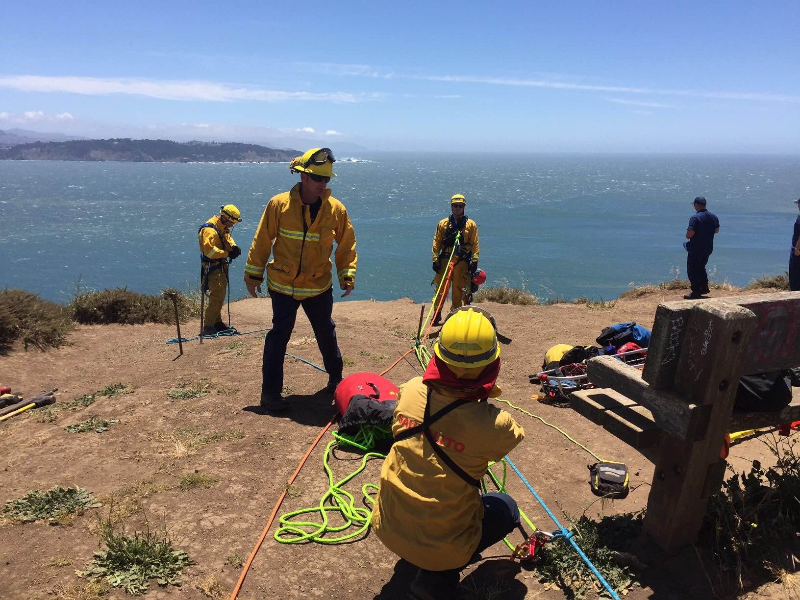 Firefighters help rescue man from cliff.