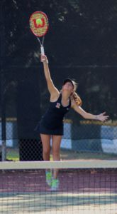 Freshman Lindsay Dubin aces a serve earning a point for her and her doubles partner, sophomore Lilly Blanadet.