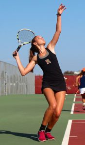 Senior captain Lindsay Thornton attempts to serve.