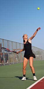 Junior Devon Cusack attempts a serve.