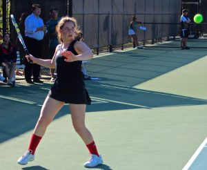 Epstein prepares to hit a forehand back to her opponent.