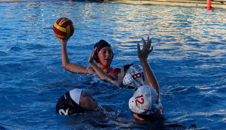 Looking for an open teammate, senior Jacqueline Racich launches a pass. Racich, one of the team captains, is hoping to help mentor the new varsity players after losing eleven players.
