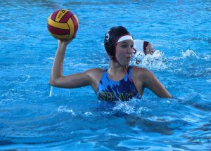 AIMING FOR THE goal, junior Ashley Lamar shoots the ball during a scrimmage on Aug. 25.