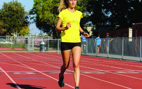 ARRIVING FROM ITALY, senior Chiara Visintini runs during cross country practice.  Visintini has impressed her coaches and teammates with her work ethic.