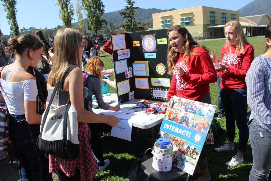 Junior Leah Gustafson explains to students what the Redwood Interact Club does.