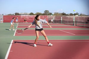 Preparing to hit a forehand, senior Lindsay Thornton watches the ball.