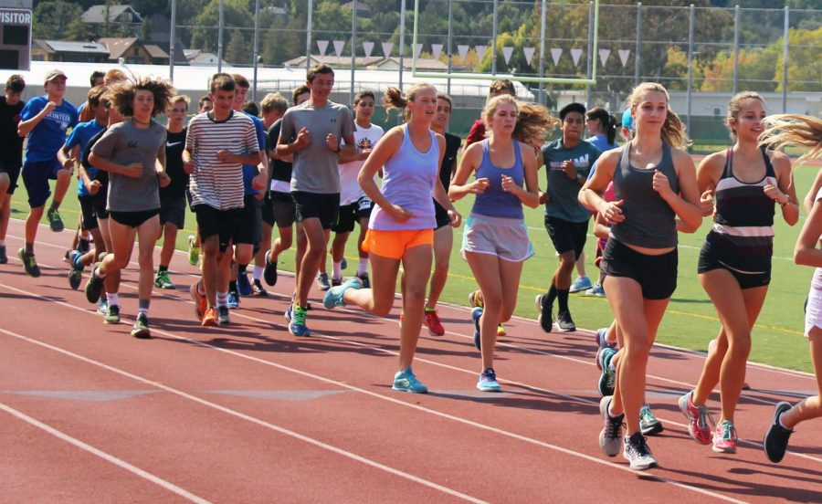 Runners finish their dynamic warmup at practice on Monday, August 22.