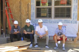 Teen Service Corps members take a break while volunteering at the Habitat for Humanity worksite in Novato.