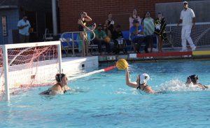 Sophomore Makenzie Allen lunges forward to take a shot on goal