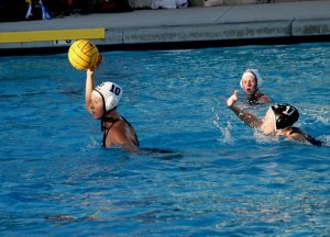 Junior Ashley Lamar looks to pass after manuvering past Novato player