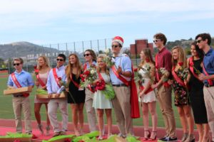 The Homecoming Court celebrates after the crowning of Landeck and Taylor.