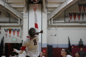 Senior outside Mckenzie Cooke reaches for the ball during the match against Justin Siena