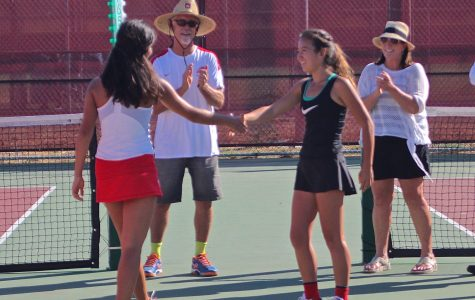 Swain shakes hands with her opponent prior t the match.