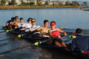 The boys' varsity rowing team practices for the upcoming Head of the Charles Regatta. A major reason for their success over the past decade has been the sense of community within the program.