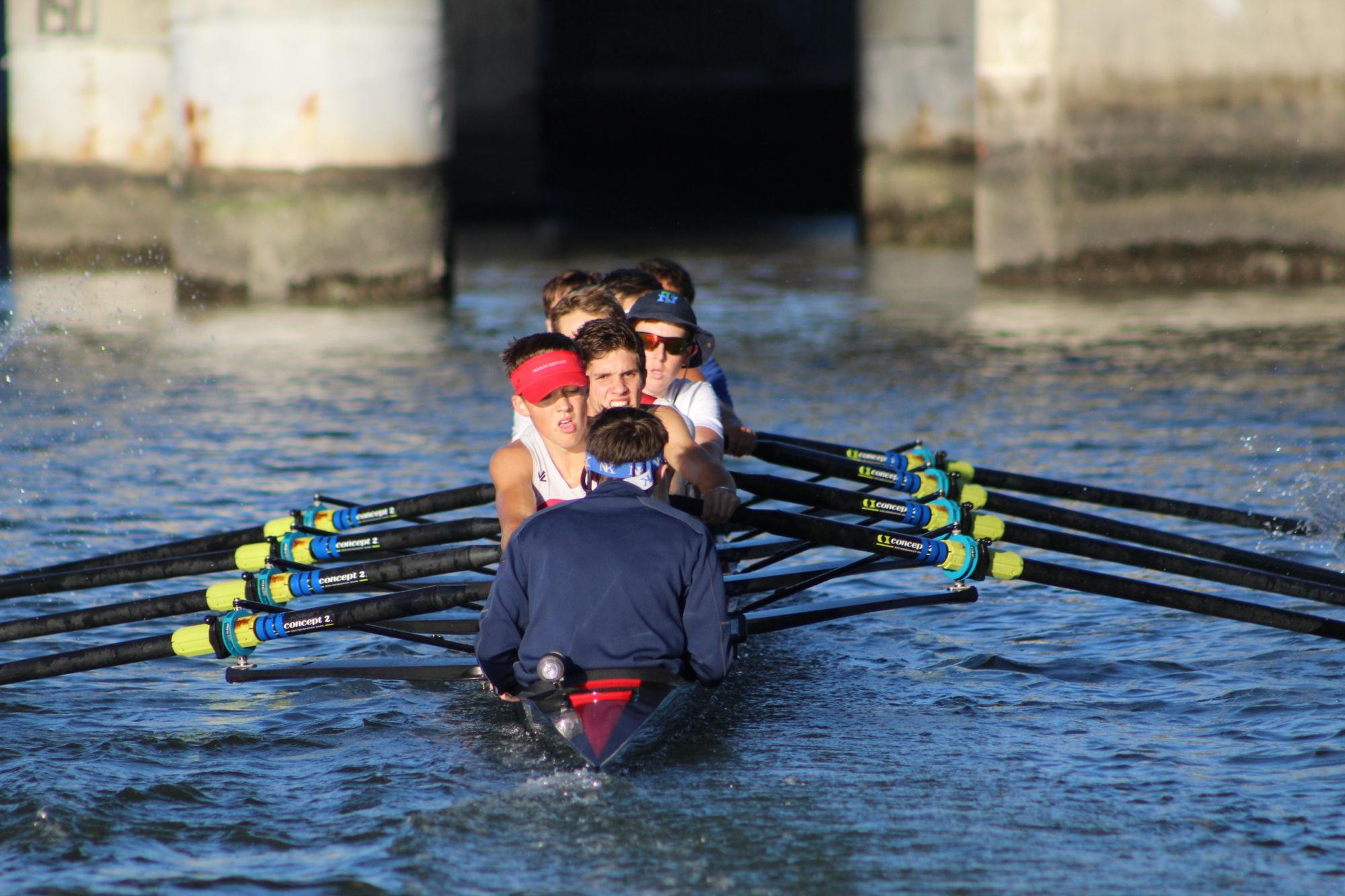 The boys' varsity rowing team shows grit and determination during practice