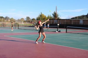 Sophomore Lilly Blanadet serves the ball to the opposing court.