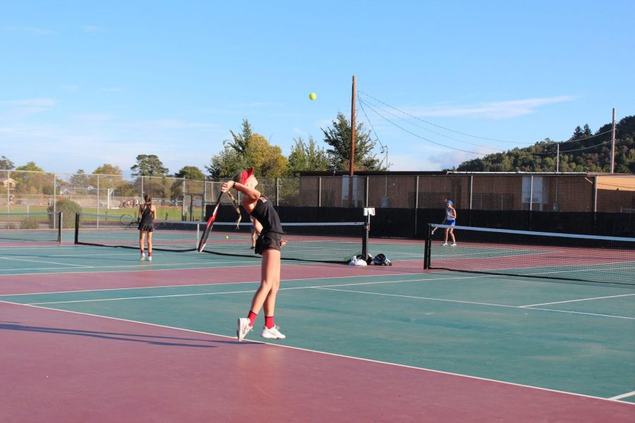 Girls' varsity tennis faces first loss of the season against Branson