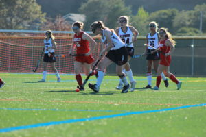 Freshman Eva Oppenheim begins to dribble the ball down the field towards the goal.