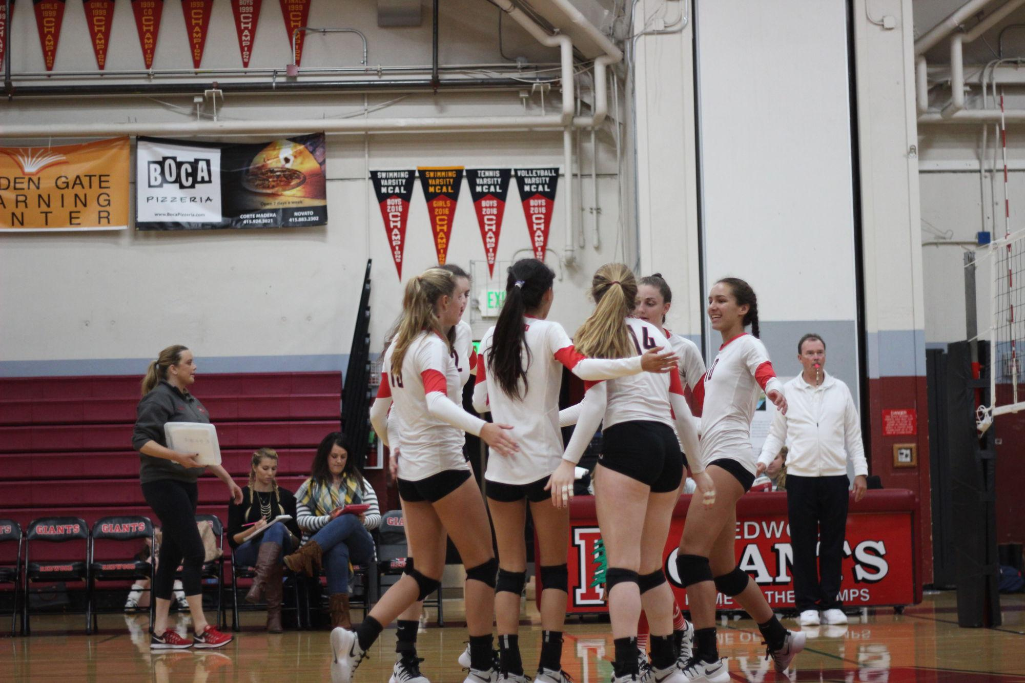 The team comes together after winning a point against Justin Siena on Tuesday, October 15