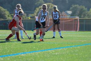 Chasing down the ball, freshman Eva Oppenheim (#17) runs ahead of the defender towards the goal.
