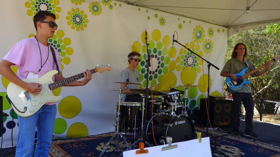 Performing at Blackie's Hay Day, veteran Canopy members Matty Michna (left) and John Van Liere (middle) play with new member and Marin Academy senior bassist Timmy Stabler.