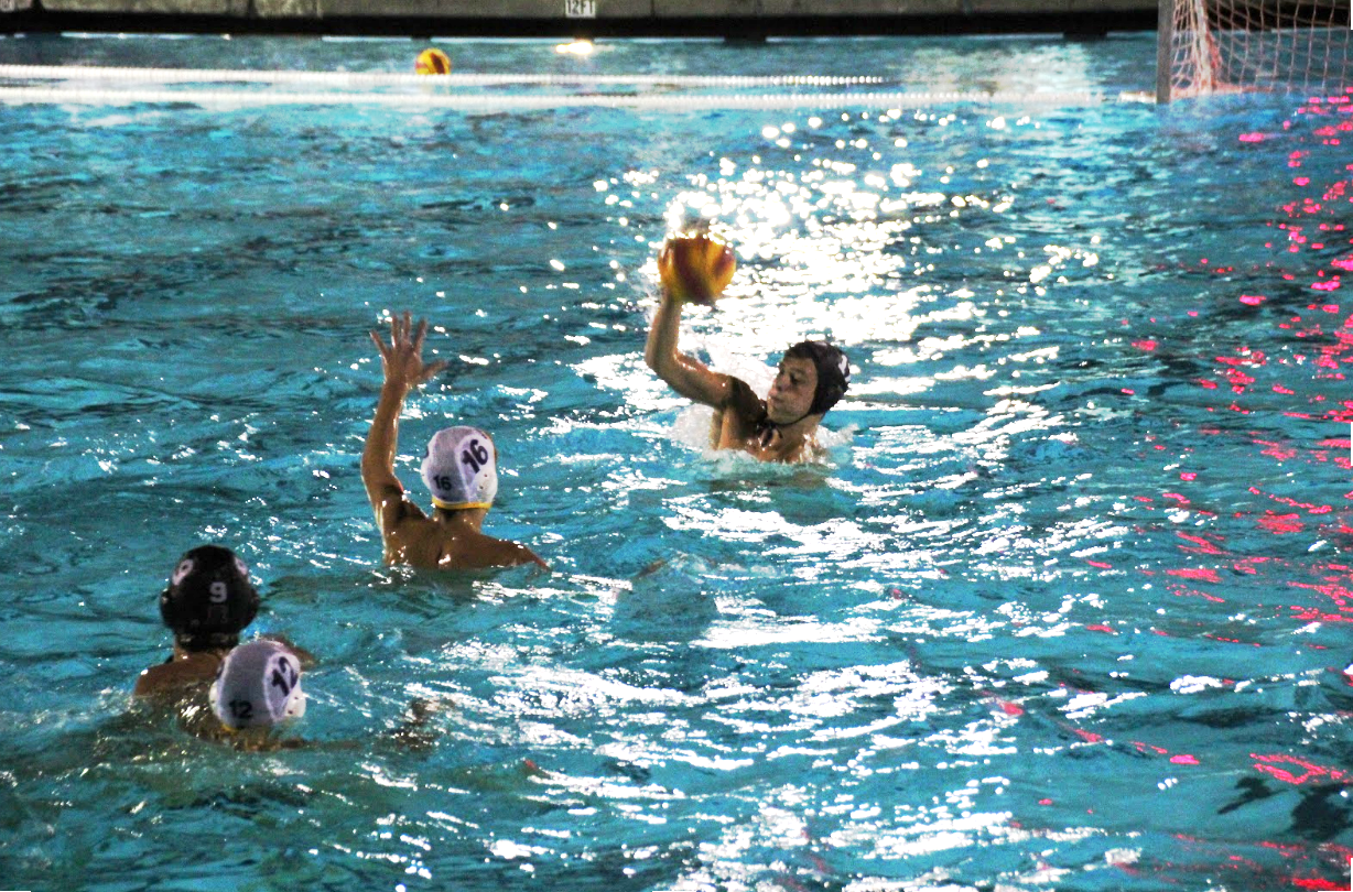 #12 Ryan Schoenlein takes a shot on goal during the 2nd half of the Redwood varsity water polo game against Ukiah.