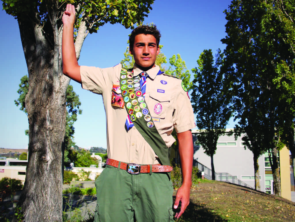 Senior+Wyatt+Barker+holds+up+his+hand+in+the+Boy+Scout+three-fingered+salute.