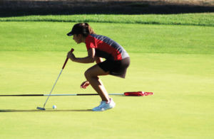 Preparing to hit the ball, senior Grace Garcia lines up her shot. Garcia showed her leadership skills this year by becoming a captain and helping the new players become familiar with the game.