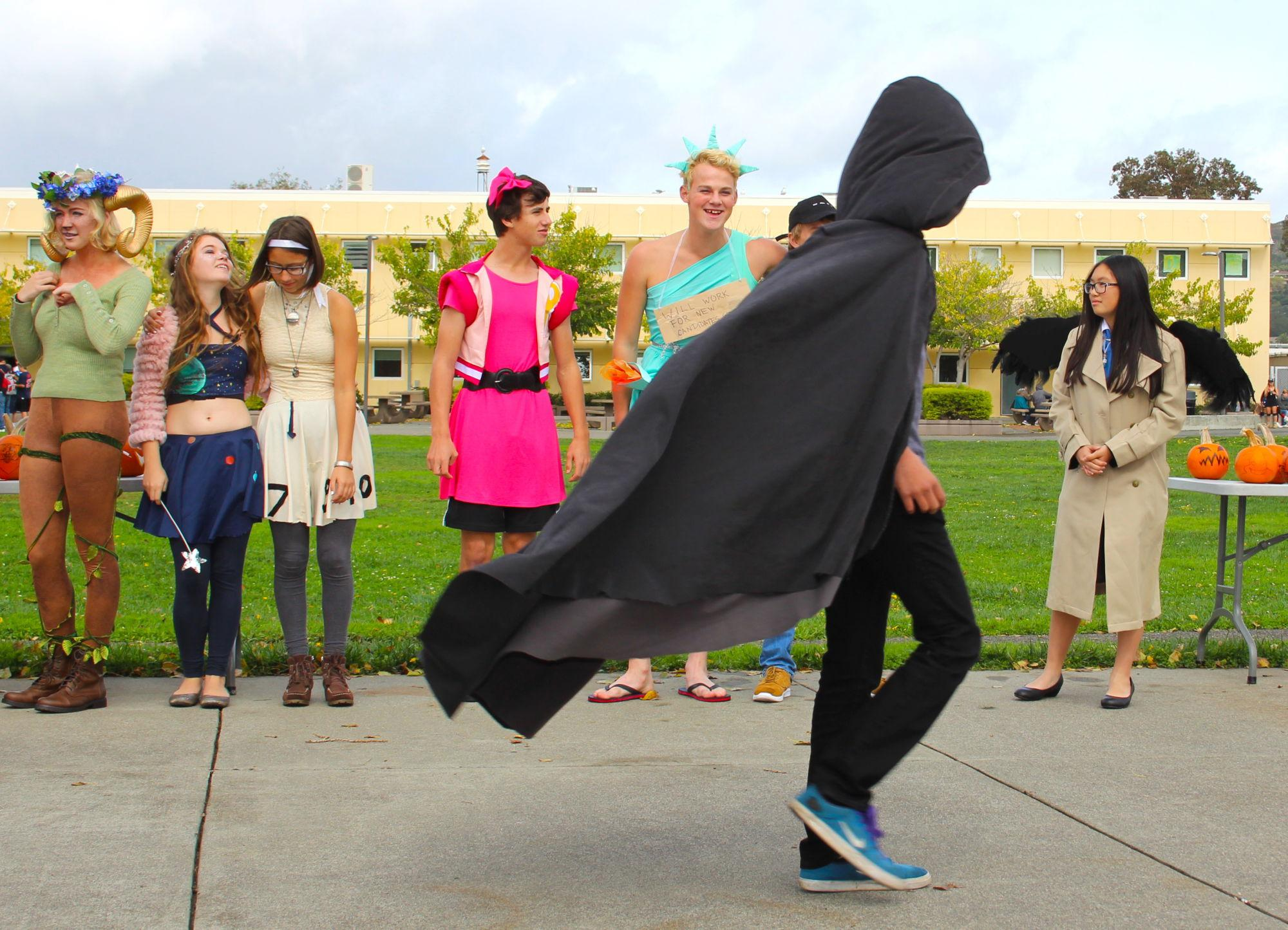 A+students+struts+his+stuff+to+impress+the+judges%2C+his+black+cape+flowing+in+the+wind.