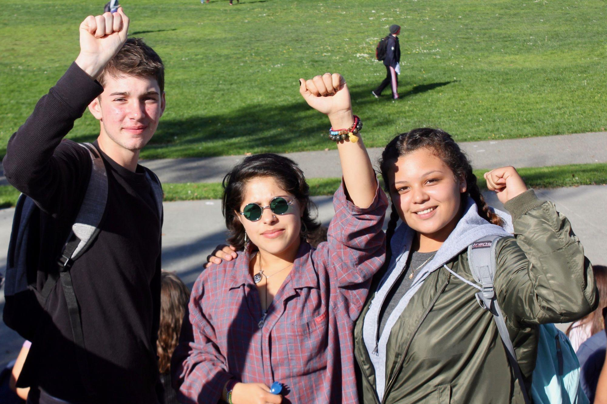 Raising their fists in solidarity with those offended by President-elect Donald Trump's campaign, students attended the Monday protest.