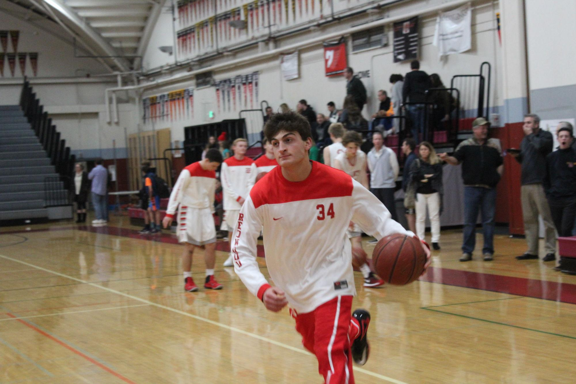 Junior Matt Mulcahy warms up before the game