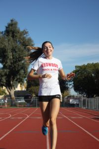 Senior shines both on the track and in the classroom
