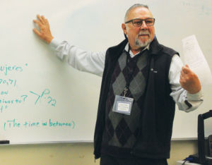 INSTRUCTING STUDENTS ON the day's lesson plan, substitute teacher Lazlo Toth believes that subs deserve an increase in pay.