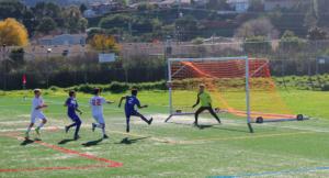 Sophomore goalkeeper Harri Hetrick prepares for a shot on goal.