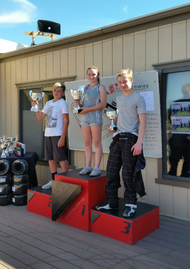 Heather beats the boys, taking the highest step on the podium
