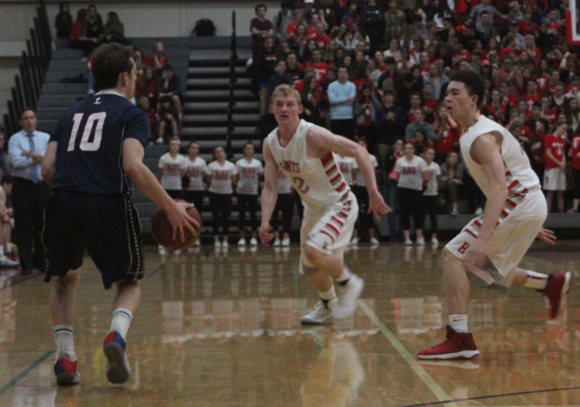 Boys' varsity basketball stifles Justin-Siena behind tenacious defensive performance