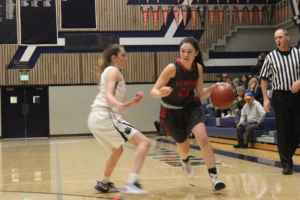 Driving to the baseline, senior Layla Dunne breaks past her defender.